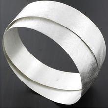 Sterling Silver Crossed Flexible Bracelet