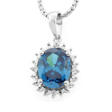 Oval Cut Blue Topaz Framed Silver Pendant