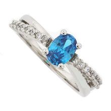 Blue Topaz Crossed .925 Silver Ring