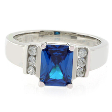 Emerald Cut Blue Topaz Ring in Sterling Silver