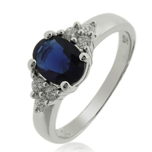 Elegant Sterling Silver Ring with Oval Cut Tanzanite Gemstone and White Zirconia