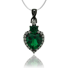 Gorgeous Black Silver Pendant With Emerald Gemstone In Heart Shape and Zirconia.