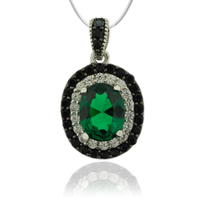 Sterling Silver Pendant With Emerald Gemstone in Oval Cut and Zirconia.
