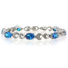 High Quality Oval Cut Blue Topaz .925 Sterling Silver Bracelet