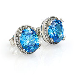 Oval Cut Blue Topaz Framed Silver Earrings
